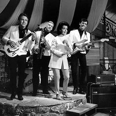 """Annette Funicello performing during the filming of """"How to Stuff a Wild Bikini"""" (with a group called The Kingsmen!)"""