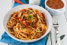 Slow Cooker Lean Spaghetti Meat Sauce - Spaghetti with a tomato-based meat sauce is a popular favorite. This recipe is prepared similarly to the way Italians make it, but with less fat. #recipes #crockpot