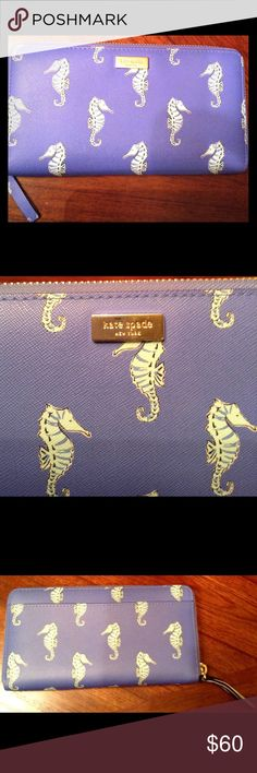"""New Kate Spade Neda Seahorses Zip Around Wallet New Kate Spade Neda Liberty Street Seahorses Zip Around Wallet WLRU2923   Like New  100% Authentic Guaranteed Retail price: $189 Color: Seaponies blue Seahorses print and gold tone hardware  Zip Around Closure  Approximate Size: 8""""L and 4""""H Outside open pocket on back Interior bill compartments with 12 credit card slots and 1 zippered pocket kate spade Bags Wallets"""