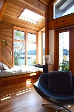 I love the seat by the window, the beautiful wood patterns, the light shining in, and the view of the water. Lake House!