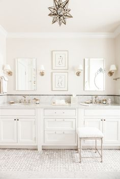 The master bathroom continues the soothing color scheme and features simple charcoal artwork of nudes.