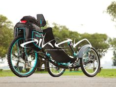 Aiken is a recumbent tadpole trike designed for long distance trips.