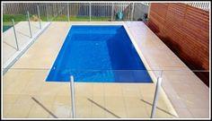Avanti lap pool design idea. Photo displays fibreglass inground lap pool in a courtyard pool setting