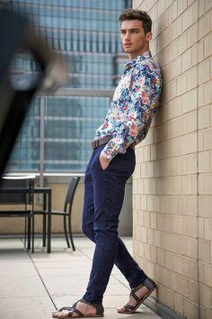 Shop this look on Lookastic: https://lookastic.com/men/looks/blue-long-sleeve-shirt-navy-chinos-dark-brown-sandals-dark-brown-belt/8753 — Blue Floral Long Sleeve Shirt — Dark Brown Leather Belt — Navy Chinos — Dark Brown Leather Sandals