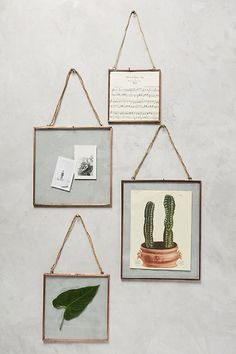 The top 25 Anthropologie home decor items you will want in your bedroom, like this set of hanging frames.