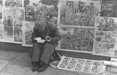 A poster seller. Pictures are from the book entitled Shanghai 1949 The End of an Era by Sam Tata (September 30, 1911 – July 3, 2005)