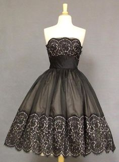 1950's cocktail dress With a pretty sweater to cover up, this would be gorgeous!