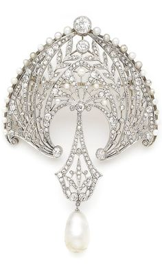 A Belle Epoque pearl and diamond brooch, circa 1910. The finely pierced cartouche of foliate design, millegrain-set throughout with cushion-shaped, old brilliant, single and rose-cut diamonds, highlighted with seed pearls, suspending a similarly-set diamond plaque and an 8.0mm natural pearl drop, length 7.1cm. #BelleEpoque #brooch