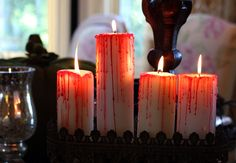 For a fun candle trick, try melting hot red candles over white pillar candles—creepy!
