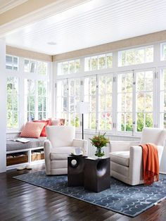 A light and bright reading nook room with wood floors and a window bench seat.