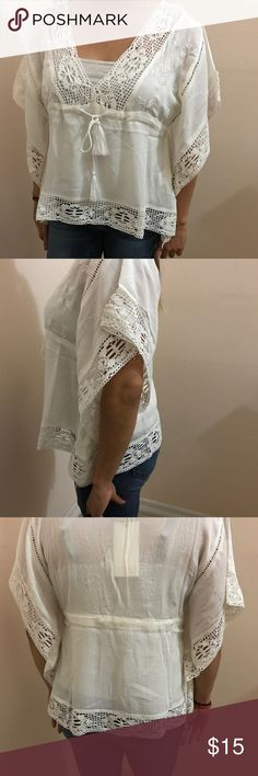 THE HANGER Crochet Top BRAND NEW Crochet Top!! Front of shirt can be adjusted to proper comfort!! Sleeves are very comfy! Top is light and airy! THE HANGER Tops Blouses