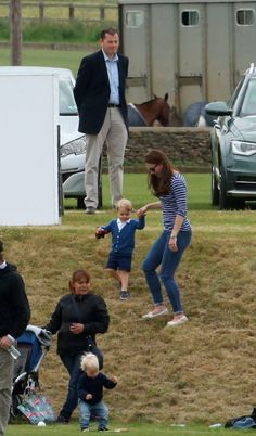 The Duchess of Cambridge with Prince George (centre) as the Duke of Cambridge and Prince Harry take part in a charity polo match at Beaufort Polo Club in Tetbury, Gloucestershire. Steve Parsons/PA Wire.