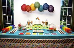 Especially love the yarn balloons, the rainbow cupcakes, the paper spinning mobiles, and the rainbow fruit tray with the marshmallow cloud. Super ideas!