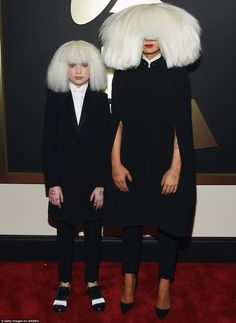 Matching: Dance Moms starlet Maddie Ziegler, 12, (left) turned up with Australian songstress Sia, 39, (right) and the duo co-ordinated their bizarre outfits. Both wore monochrome pantsuits with enormous choppy white wigs