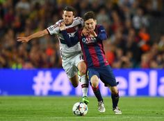 Lionel Messi of Barcelona and Juan Bernat of Bayern M��nchen battle for the ball during the