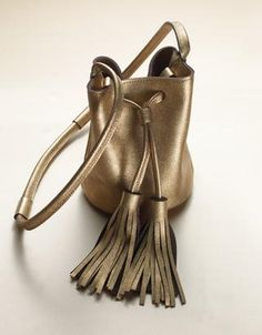 2015 Holiday Gift Guide This tasseled mini bucket bag in burnished gold leather by Georgia's Very Fine South is just the right size for fun days (and nights) when you'd rather lighten your load.