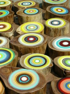 we used to sit around the firepit on stumps, but i like these with the painted bullseyes!