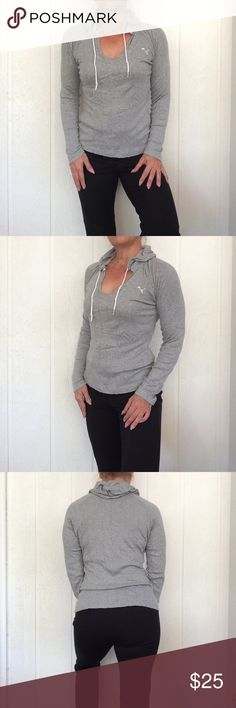"PUMA GREY MARLED LIGHTWEIGHT PULLOVER EUC grey marled pullover pre or post workout top. Gorgeous knit fabric with open weave dots make this cool enough to wear during workouts. Attached hood with logo drawstrings.  Embroidered white Puma cat at chest. Pullover v neck style.  Stretch fabric. Tagged large but could fit a small or medium as well depending on how you like your fit. I'm a a small and I wear it.  No rips, stains, holes, piling or defects.  Bust 18-1/2"", sleeve length from neck…"