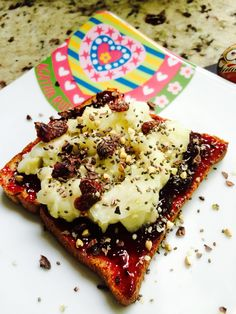 Dessert for breakfast. Delicious wheat toast with blackcurrant and soursop (guanabana) topped with chia seed, buckwheat and hemp cereal sprinkles of course