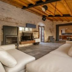 Salones de estilo rústico de Viviana Pitrolo architetto