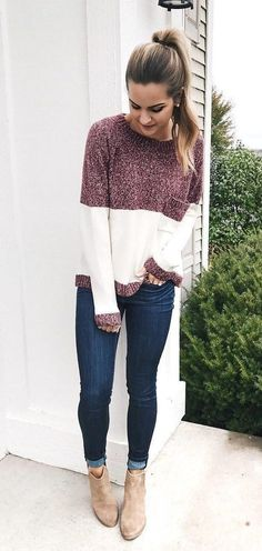 #winter #outfits  maroon and white crew-neck sweater, blue jeans, and pair of brown booties