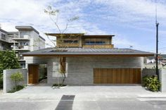 Modern Face of Japanese House Architecture with Natural Exterior Color