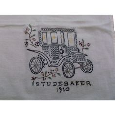 This is a hand embroidered towel or small tablecloth, cover showing a vintage 1910 Studebaker car. Measures 34 inches by 29 inches and is in great