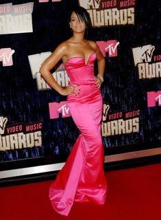 Hot Sizzling Pink | Rihanna is everywhere we look these days. Is she going to be touring with Kanye? Is her album about to drop? Is she dating Leo DiCaprio? The one thing we do know is Rih-Rih knows how to rock a red carpet. Here are 100 of Rihanna's boldest, loudest and outright most provocative looks.