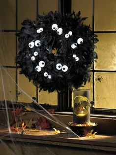 We love this Spooky Eyes Halloween Wreath tutorial from favecrafts.com!  Get the black boa for this project here, http://www.craftsfeathersfloral.com/home/cff/page_7055_1129/chandelle_boa_black.html