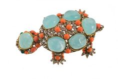 An Iradj Moini goldtone turtle brooch, set with green : Lot 1291