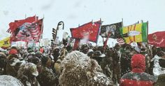 Veterans and water protectors unite in prayer, calling for an end to the entire Dakota Access Pipeline project, in the midst of a blizzard Monday.