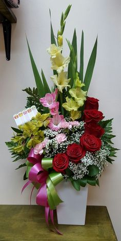 Take a look at this cool white flower arrangements - what an artistic design Gladiolus Arrangements, Funeral Floral Arrangements, Tropical Flower Arrangements, Creative Flower Arrangements, Artificial Floral Arrangements, Church Flower Arrangements, Beautiful Flower Arrangements, Beautiful Flowers, Altar Flowers