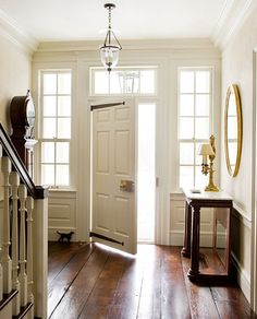 beautiful entry - love the old door and hardwoods