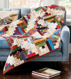 Winding Ways  is a throw size quilt pattern featuring log cabin quilt blocks. Designer Jane Vaughan hit upon this winning arrangement. You can duplicate her creation with 80 identical blocks joined in a variety of directions. Quilted by Anne Alessi.