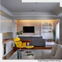 A poltrona amarela foi a sensação deste ambiente. Combinada com tons neutros ficou sensacional. Outro detalhe que amamos foi a TV direto na parece com uma iluminação suave acima. Por Thaisa Camargo  @Sidney.doll.3 Ad . http://ift.tt/1U7uuvq arqdecoracao arqdecoracao @arquiteturadecoracao @acstudio.arquitetura  #arquiteturadecoracao #olioliteam #interiores #design #home #world #perfect #photooftheday #instago #decoracao #construcao #instadecor #architecture #instamood #arquiteta #love #decor…