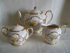 THIS BEAUTIFUL RARE SADLER TEAPOT SET, BEING THE ARABESQUE, ROUND CUBE SHAPE, IN A LIGHT CREAMY/IVORY COLOUR, IS ADORNED WITH THE DELICATE FLORAL SPRAYS, EDGED WITH GOLD BANDING/RAISED ACCENTS, AND IS ALL FULLY STAMPED ON THE BASES TOGETHER WITH THE GOLD PAINTED MARKS. | eBay!