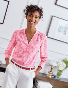 This drapey blouse is as easy to wear as it is stylish, with a fluid polyester fabric that's simple to wash and doesn't crease. This button-down design has a flattering neckline and feminine gathers along the shoulders. Tuck it into a smart pencil skirt, or wear with laid-back chinos.