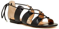 Ciao Bella Luca Leather Sandal The flat Luca sandal's lace-up vamp and back tie bow detail is a fresh, cropped alternative to standard leather gladiators.