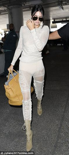 Kendall Jenner flashes nipple at LAX in semi-sheer crochet top #dailymail