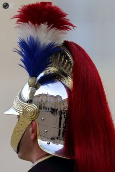 The Elysee Palace in Paris is reflected in the helmet of a Republican Guard.