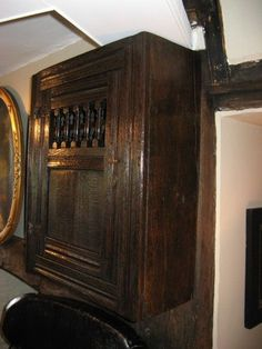 """17TH CENTURY OAK SPINDLE FOOD CUPBOARD. WITH CHANEL MOULDED FRONT. THE DOOR WITH IRON BUTTERFLY HINGES AND SPINDLE TOP ABOVE A PANEL, WITH SHELVED INTERIOR. EXCELLENT COLOUR AND . PATINATION 27.5"""" HIGH X 22.5"""" WIDE X 9"""" DEEP. Century, Wood, Oak, English Furniture, Oak Spindles, Oak Furniture, Paneling, Cupboard, Century Furniture"""