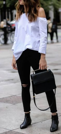 trendy outfit idea one shoulder top + rips + bag + boorts
