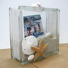 As the last days of summer slip away, keep those fond memories of vacations and day trips alive throughout the whole year with this Seaside Shadowbox. This fun project uses the Kraftyblok as the pr...