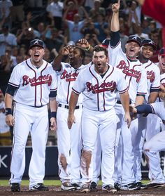 ARE YOU SERIOUS?! The Braves wait at home plate as Chipper rounds the bases following his walk-off homer.    (Photo by Pouya Dianat/Atlanta Braves/Getty Images)