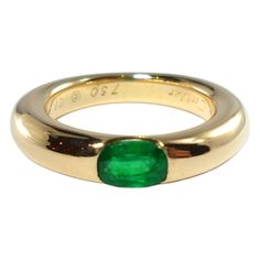 CARTIER Ellipse Emerald Ring | From a unique collection of vintage band rings at https://www.1stdibs.com/jewelry/rings/band-rings/