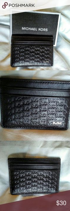 Michael Kors Jet Set Card Holder Textured card case from Michael Kors with logo-debossed exterior and polished logo lettering. Has two card slots on front and back and one bill compartment in the interior. Michael Kors Accessories Key & Card Holders