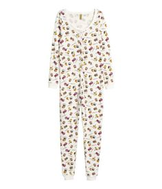 All-in-one pyjamas in soft cotton jersey with an all-over print, long sleeves, long legs, press-studs down the front and ribbing at the cuffs and hems.