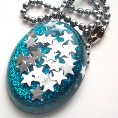 Glitter and stars make a beautiful resin pendant.