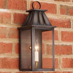 Check out Mansard Outdoor Wall Light from Shades of Light The mansard style design of this wall lantern adds interest and an architectural element to outdoor lighting. Our local artisans apply an aged blackened finish on the copper, producing a gunmetal patina. Clear glass panels. Made in America. Copper is a living metal that will change and patina gradually to a rich, dark color over time.