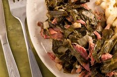 Smoked turkey drumsticks or wings, or ham hocks can be used in this Slow Cooker Collard Greens recipe to impart that traditional smokiness into the greens. Other options? Many cook and add smoked bacon instead to greens for the same effect. #HamIAm!, #ThanksgivingRecipes, #slowcooker